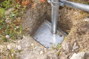 Pied-platine enterré : une sérieuse fixation au sol d'une serre